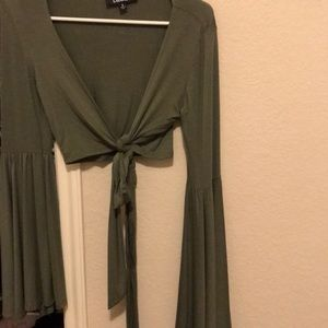 Green tie front with bell sleeves crop top.
